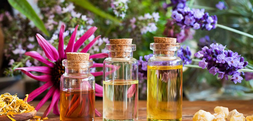 Bottles Of Essential Oil With Dried Calendula, Frankincense Resi